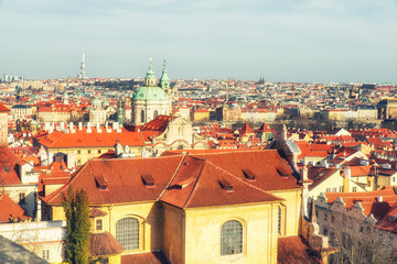 View of Prague: Vrtbovska Garden, Saint Nicholas Church, tiled roofs on blue sky background