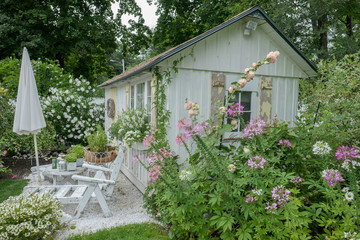 Weathered wood and shutters with summer flowers on a Maine Cottage