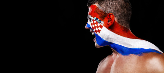 Soccer or football fan with bodyart on face with agression - flag of Croatia.