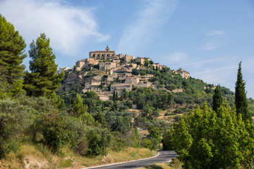 The medieval hilltop town of Gordes in Provence. France as seen from the road below