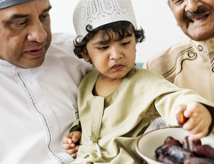 Muslim boy eating dried dates