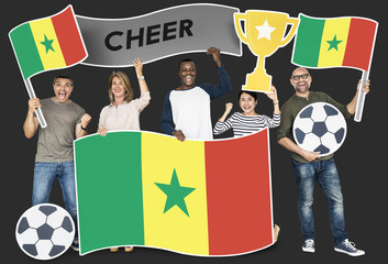 Diverse football fans holding the flag of Senegal