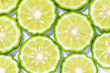 Sliced bergamot on white