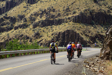 Bicyclists ride through Picture Gorge