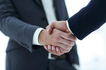 close up of two young male business partner shake hand