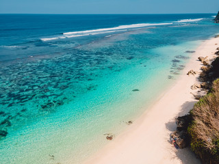 Aerial view of tropical beach with turquoise ocean in Bali, Indonesia