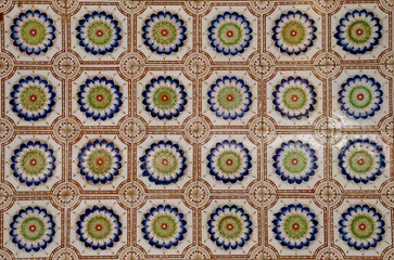 Close up view of ceramic tiles with a floral design in the style of traditional Peranakan shop frontages