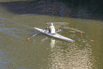 A person rowing boat on Arno River, Florence, Italy