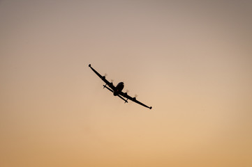 Four engine prop plane at sunset