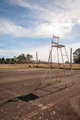 Umpires chair on abandoned tennis court