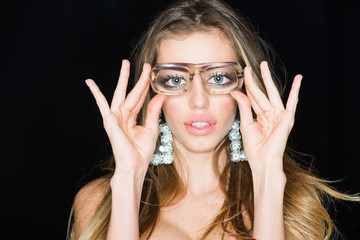 Now I can see you well. Sensual woman wear fashion glasses. Woman with magnified eyes. Nerd girl with funky look. Beauty model with long blond hair and makeup