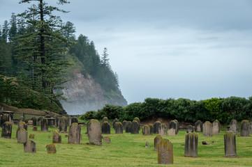 Misty and ancient graveyard, Norfolk Island Australia