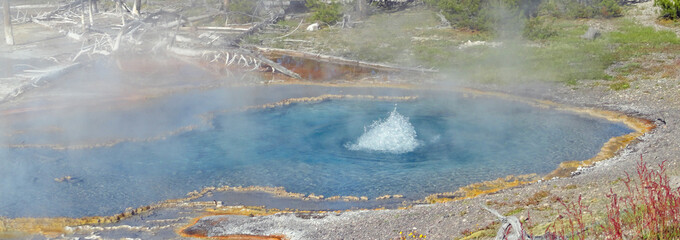 Firehole Spring boiling up on Firehole Lake Drive in Yellowstone National Park in Wyoming United States