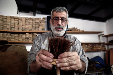 Visually impaired Palestinian man makes a cleaning brush inside a workshop at Blind Caring society, in Nablus in the occupied West Bank