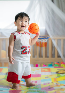 Baby with ball in basketball uniform, this immage can use for play, sport, baby, child, kid and exercise work