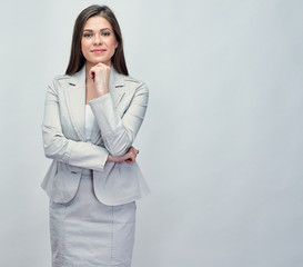 Smiling businesswoman in gray business suit.