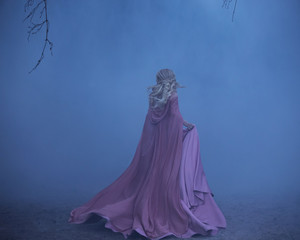 A frightened girl blonde runs in a thick fog. On the elf, a luxurious pink dress with a long train and a raincoat. The photo from the back without a face. Artistic retouching.