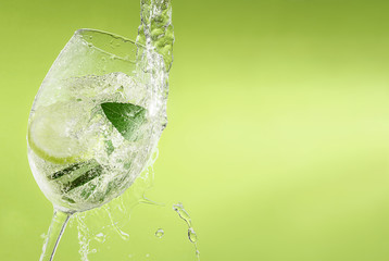 cold drink cucumber mint lime pours into a glass