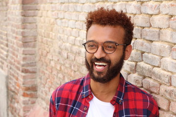 Cheerful racial male smiling with copy space