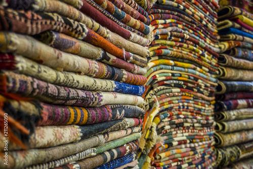 A Pile Of Carpets In Turkish Carpet Shop