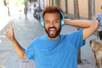 Funky ethnic man listening to music