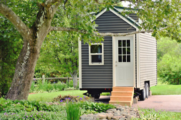 Tiny gray house on wheels