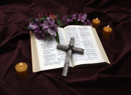 Bible and candles and flowers