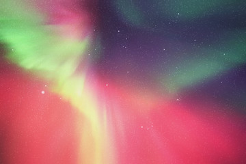 Vector illustration with beautiful starry sky and Northern lights. Abstract colorful background with red-green aurora borealis