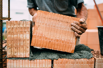 masonry details - professional constructor, worker building exterior walls