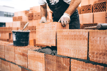 close up details of worker, bricklayer. Professional worker building house