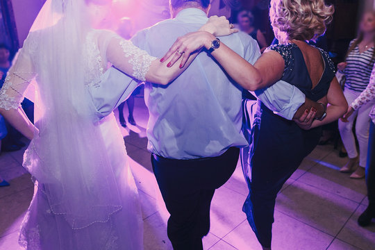 bride and groom having fun and dancing at wedding reception. holiday celebrations.  people dance at party in restaurant