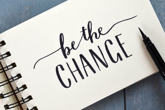 BE THE CHANGE hand-lettered in notebook