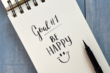 Goal No. 1 BE HAPPY hand-lettered in notebook