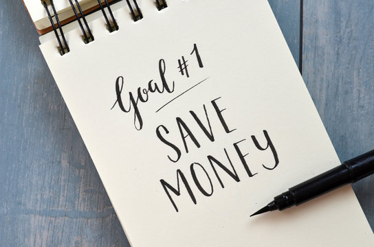 Goal No. 1 SAVE MONEY hand-lettered in notebook