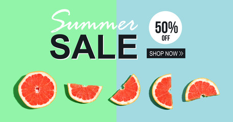 Summer sale message with halved fresh grapefruits