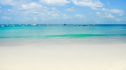 Boats in paradisiac turquoise beach in the Caribbean