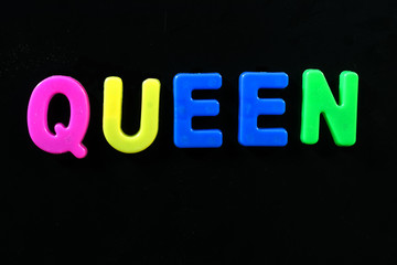 English letters in black background are the words queen