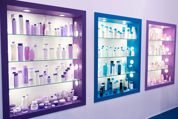 Showcase shop with plastic bottles cosmetic and shampoo