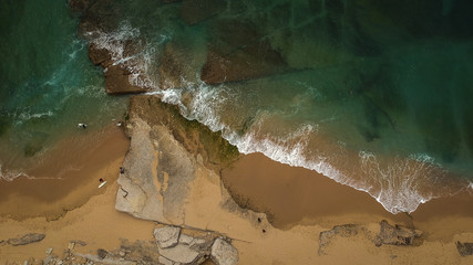 surfer on the beach top view. Drone shot on a beach in a summer day.