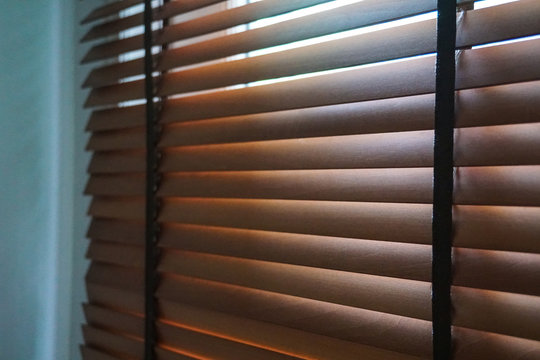 brown wood blind shade curtain and shadow