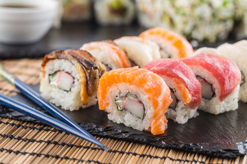 Set of roll sushi gold california with chopsticks and soy sauce.