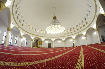 View of hall for praying (iwan) of the Ar-Rahma Mosque (Mercy Mosque) with minbar (pulpit). Just before celebrating nowruz (Turkic New Year). March 21, 2018. Kiev, Ukraine