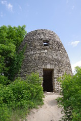 stone fortress tower by the forest