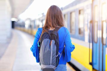 Young woman tourist at platform train station