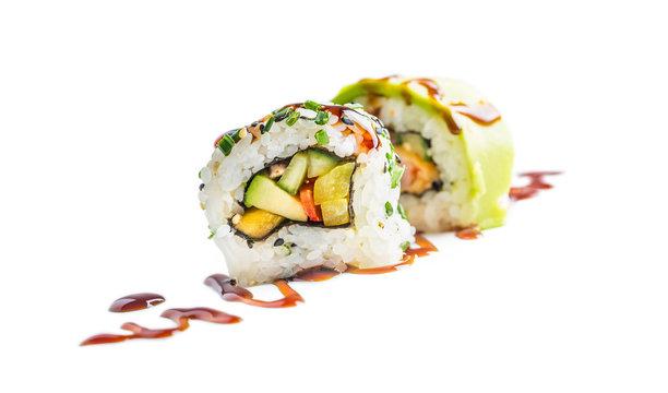 Sushi uramaki with soy sauce isolated on white background