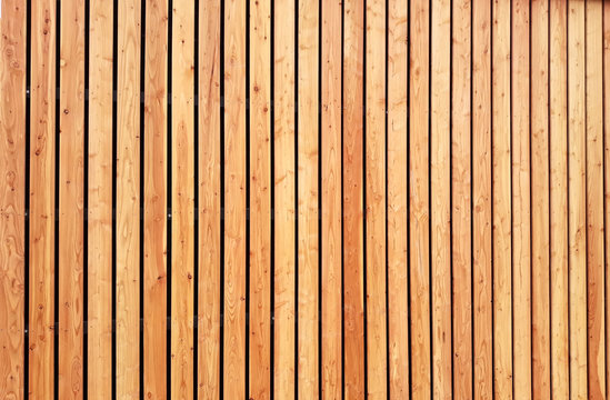 Larch wooden planks facade texture background
