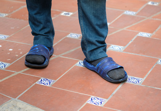 Men's feet in socks and sandals