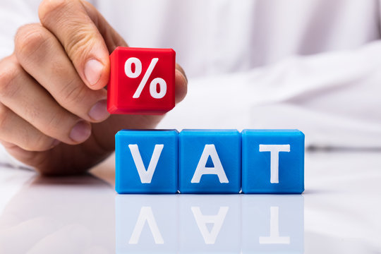 Person Placing Red Percentage Block Over Vat