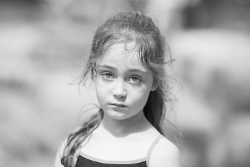 Portrait of little girl in summer in park