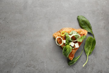 Piece of tasty pie with spinach on table
